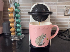 Marianne makes her coffee
