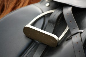 leather saddle on horse back
