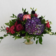 Load image into Gallery viewer, Red Fox Floral. Large Berry Centerpiece. A luxurious arrangement with picked from the garden texture made with a mix of deep purples, berry, and hot pink flowers. Includes garden roses, spray roses, ranunculus, lisianthus, stock, carnations, hydrangea with eucalyptus and green foliage.