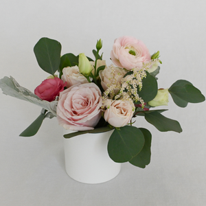 Red Fox Floral. Blush Accent Arrangement. A petite gathering of garden roses, spray roses, ranunculus, lisianthus and blush accents with eucalyptus and green foliage.