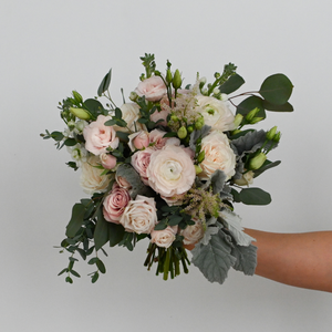 Red Fox Floral. Blush Bridal Bouquet. A loose, picked from the garden style bouquet made with beautiful white and blush flowers such as garden roses, spray roses, ranunculus, lisianthus, blush accents and a mix of eucalyptus and green foliage.