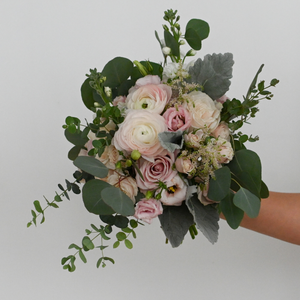 Red Fox Floral. Blush Bridesmaid Bouquet. A loose, picked from the garden style bouquet made with beautiful white and blush flowers such as garden roses, spray roses, ranunculus, lisianthus, blush accents, and a mix of eucalyptus and green foliage.
