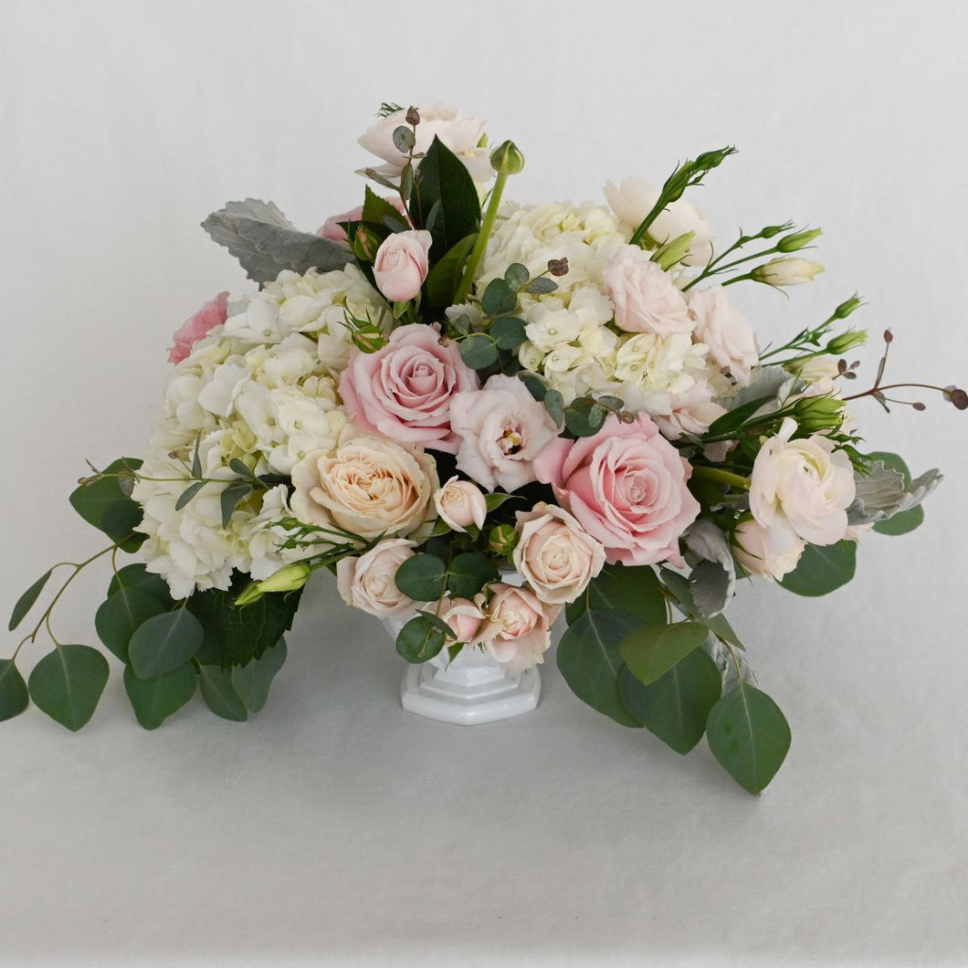 Red Fox Floral. Large Blush Centerpiece. A luxurious arrangement with picked from the garden texture made with blush and white garden roses, spray roses, ranunculus, lisianthus, blush accents with eucalyptus and green foliage.