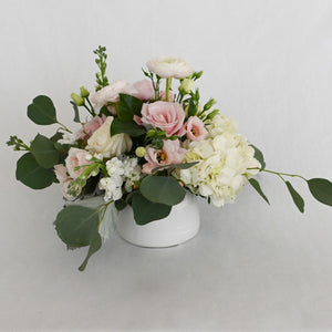 Red Fox Floral. Small Blush Centerpiece. A low and lush arrangement with picked from the garden texture made with blush and white garden roses, spray roses, ranunculus, lisianthus, blush accents with eucalyptus and green foliage.