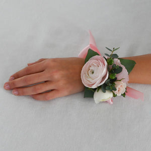 Red Fox Floral. Blush Corsage. A wrist corsage made with blush flowers, white accents and greens tied with blush satin ribbon.