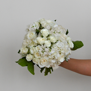 Red Fox Floral Classic Elegance Bridal Bouquet. A traditional rounded bouquet made with classic white flowers such as hydrangea, roses, spray roses, and stock with hints of green foliage.