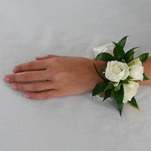 Load image into Gallery viewer, Red Fox Floral Classic Elegance Corsage. A wrist corsage made with White spray roses and accent greens tied with white satin ribbon.
