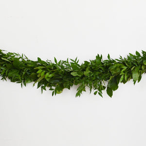 Red Fox Floral. Dark Green Garland, horizontal view. A mix of darker greens such as Italian ruscus and salal greens.