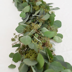 Red Fox Floral Eucalyptus Garland, vertical view. A mix of eucalyptuses to include silver dollar and seeded eucalyptus.