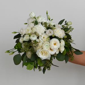 Red Fox Floral Romantic Garden Bridal Bouquet. A loose, picked from the garden style bouquet made with beautiful white flowers such as garden roses, spray roses, ranunculus, football mums, lisianthus, and a mix of eucalyptus and green foliage.