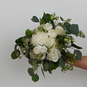Red Fox Floral Romantic Garden Bridesmaid Bouquet. A loose, picked from the garden style bouquet made with beautiful white flowers such as garden roses, spray roses, ranunculus, football mums, lisianthus, and a mix of eucalyptus and green foliage.