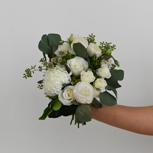 Red Fox Floral Romantic Garden Nosegay. A loose, picked from the garden style nosegay made with beautiful white flowers such as garden roses, spray roses, ranunculus, football mums, lisianthus, and a mix of eucalyptus and green foliage.