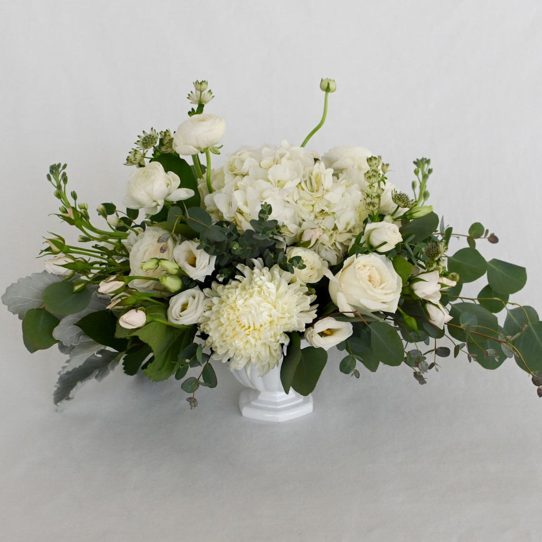 Red Fox Floral Large Romantic Garden Centerpiece. A luxurious arrangement with picked from the garden texture made with garden roses, spray roses, football mums, ranunculus, lisianthus, white accents and eucalyptus and green foliage.