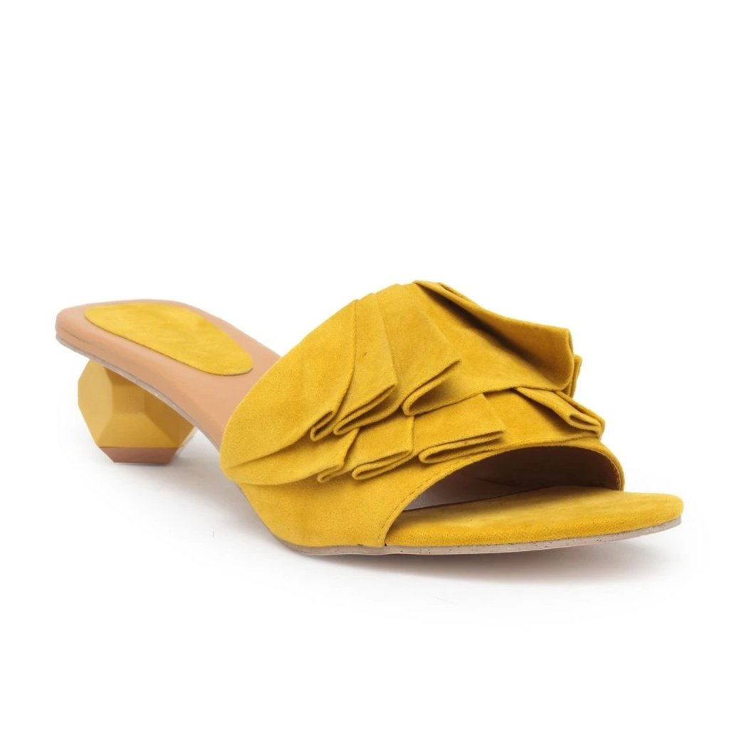 Slip on style block heels from our 'Pleats Please' Collection.  Featuring a canary suede upper with a two-inch assymetric block heel.  Shoe Care: Wipe with a clean, dry cloth to remove dust.
