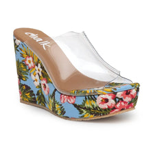Load image into Gallery viewer, Beach days are here! Welcome to the Bahamas! Transparent, slip-on style wedges with 4-inch high heels covered in a tropical print canvas. Lightweight style made with a state-of-the-art rubber sole.