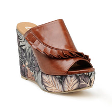 Load image into Gallery viewer, Our Classic open toe wedges from our 'Pleats Please' collection. Tan pleated upper in slip-on style, with an abstract tropical print. Featuring a 4-inch high wedge heel crafted from state of the art materials.
