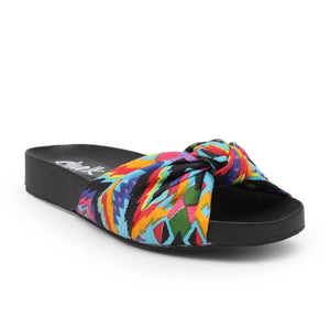 Its beach day!! Planning your next vacation, these are a must and the most comfortable flats! Slip-on style sandals with a knotted bow detailing on top in printed kaleidoscope color Made with super-soft padded lining with a comfy and durable rubber sole.