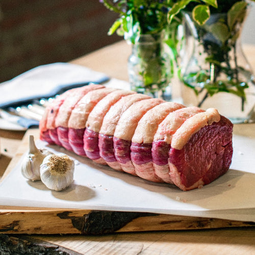 Organic grass-fed Sussex beef silverside roasting joint displayed on a chopping board at the Goodwood Farm Shop.