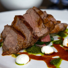 Load image into Gallery viewer, Roasted leg of organic grass-fed lamb. This is a leg of lamb recipe served at the Goodwood Bar and Grill restaurant.