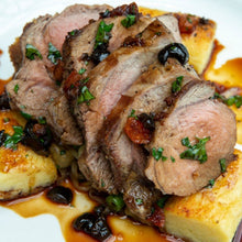 Load image into Gallery viewer, An organic leg of lamb recipe served on a plate with sauerkraut potato gnocchi, fine beans and black olives.