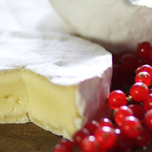 Load image into Gallery viewer, Goodwood's rich and creamy Levin Down soft white cheese, displayed on a cheese board with red berries.