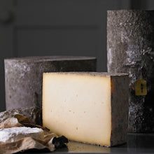 Load image into Gallery viewer, Goodwood's Charlton farmhouse cheese ready to be sliced for a cheese board, available at Goodwood Farm Shop.