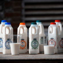 Load image into Gallery viewer, The variations available of Goodwood Organic Milk  - whole milk, semi-skimmed milk and skimmed milk.