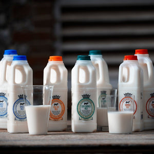 The variations available of Goodwood Organic Milk - whole milk, semi-skimmed milk and skimmed milk.