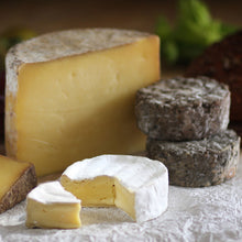 Load image into Gallery viewer, Close up of the Goodwood Cheese Board Trio, containing Goodwood's handmade mature Charlton Cheese, Levin Down and Molecomb Blue.