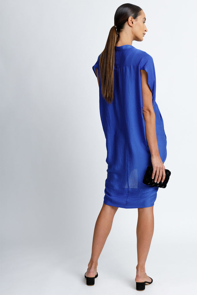 FORMERLY YAN Maternity Figure Flattering Button Down Shirt Dress with Cap Sleeves and Self Tie. Knee Length. Cobalt. Adjustable to Wear During and After Pregnancy. Nursing Friendly - Back View