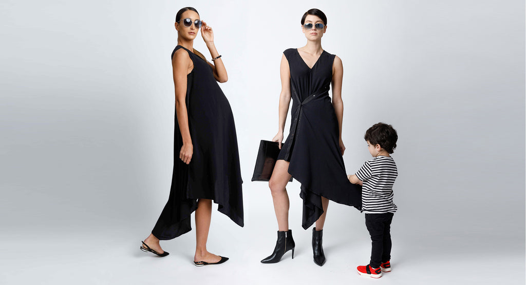 Sleeveless V-Neck Midi Snap Dress with Asymmetrical Hem in Black Crepe Back Satin Convertible to Wear During and After Pregnancy