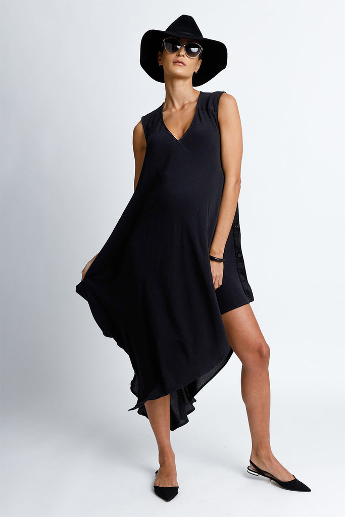 Sleeveless V-Neck Midi Maternity Snap Dress with Asymmetrical Hem in Black Crepe Back Satin Convertible to Wear After Pregnancy