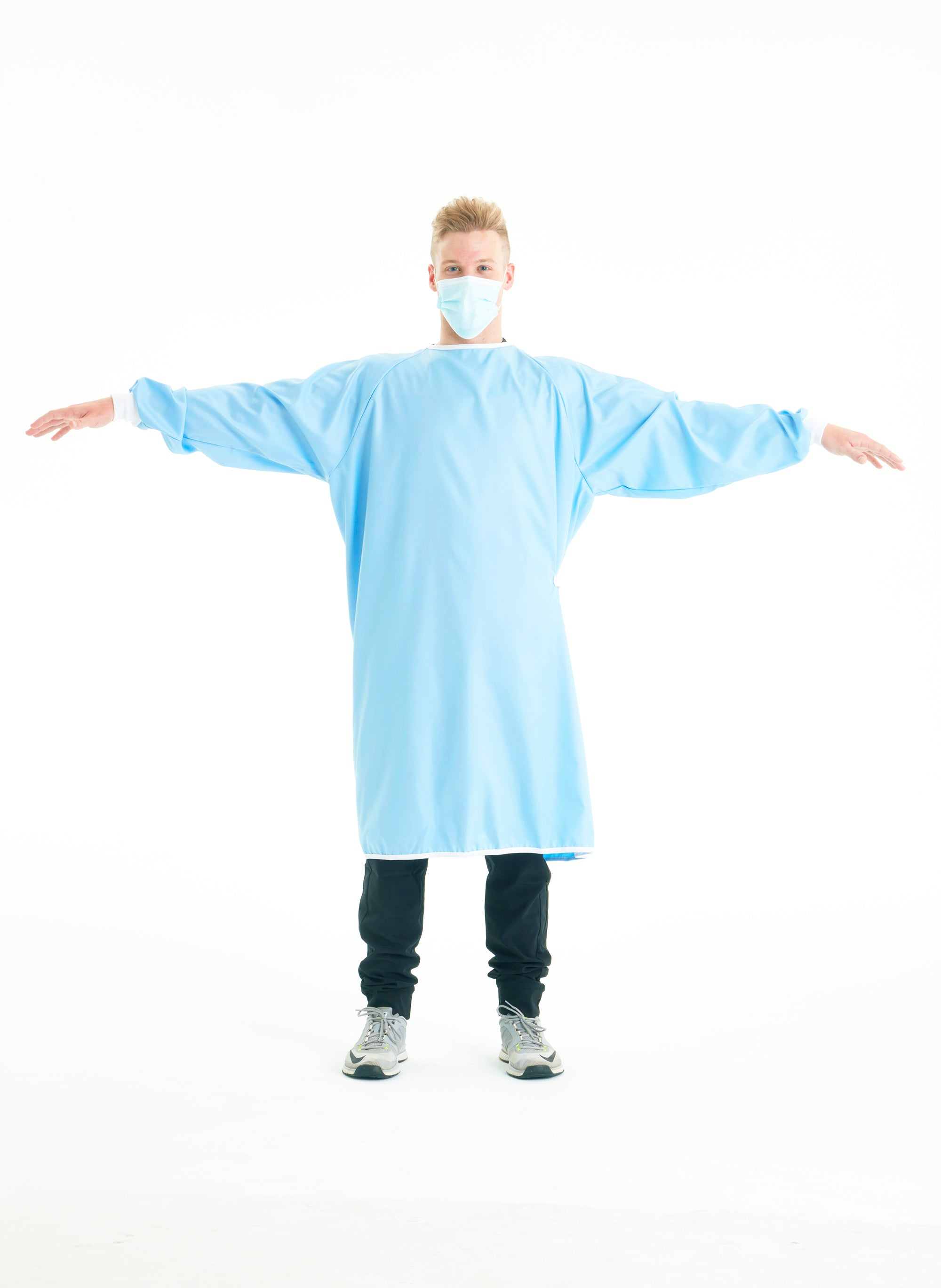 man-with-arms-wide-showing-off-blue-reusable-level-2-gowns