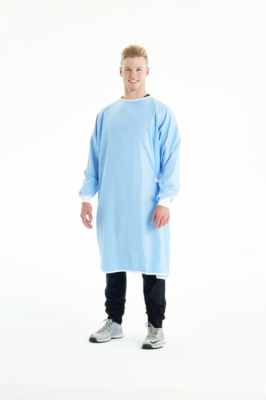 man-smiling-while-wearing-blue-reusable-level-2-gown