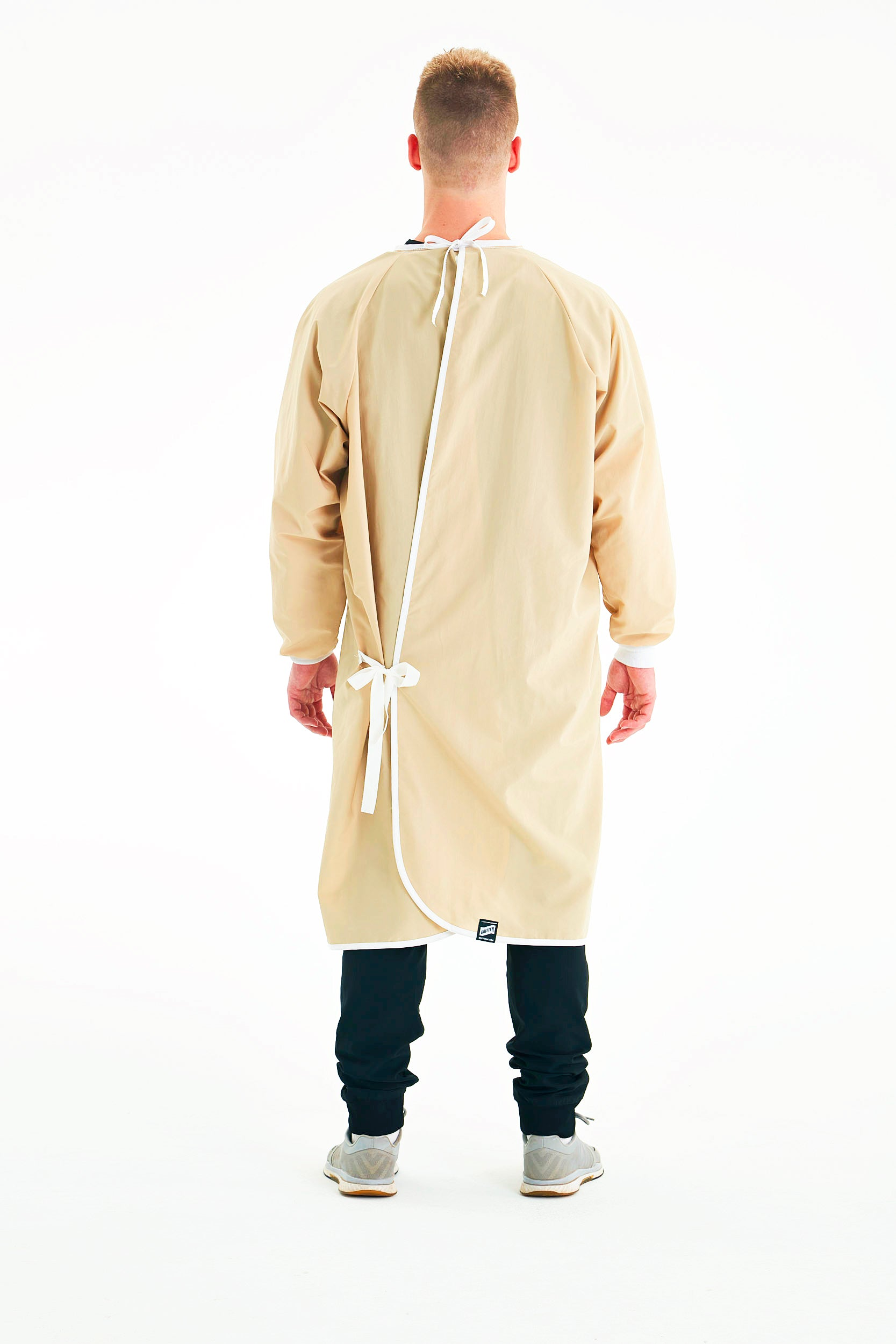 man-in-mask-wearing-khaki-reusable-level-2-gown