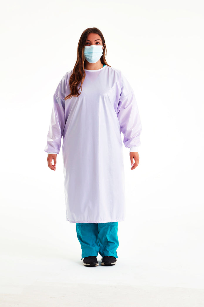 woman-in-mask-wearing-reusable-level-3-gown-in-light-lavender