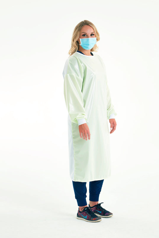 woman-in-mask-wearing-reusable-level-3-gown-in-light-green