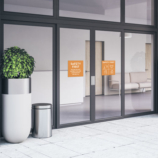 medical-office-entrance-with-safety-first-window-decals-in-orange