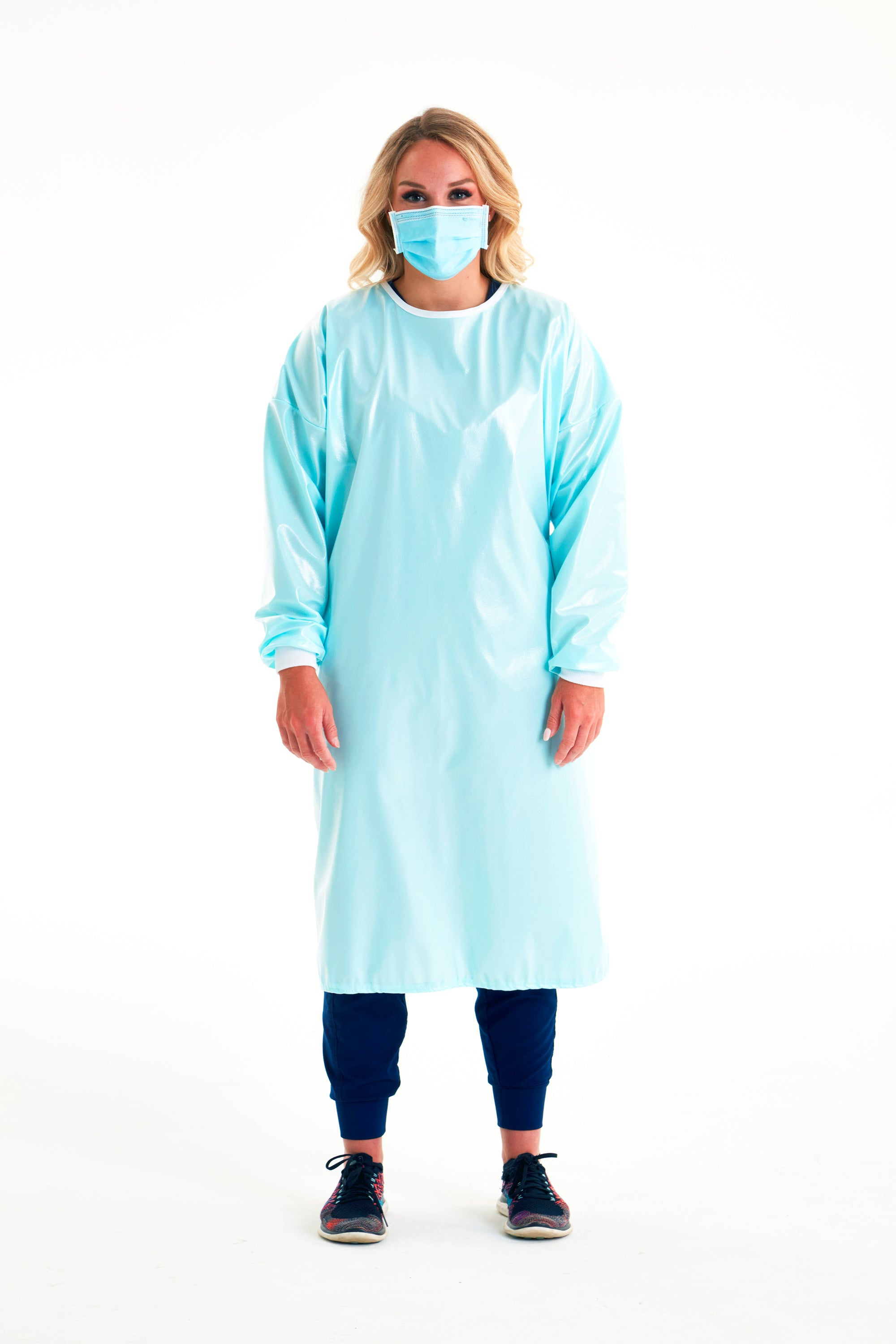 woman-in-mask-wearing-reusable-level-3-gown-in-seaspray