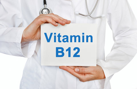 Doctor holding a Vitamin B12 sign