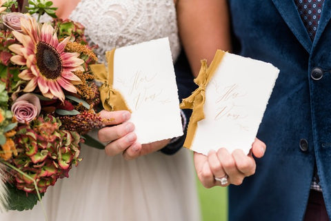 mustard silk ribbon on wedding vow books