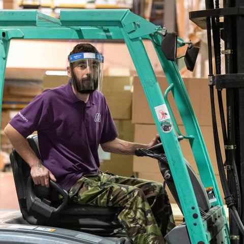 Medworx face shields being used in a warehouse