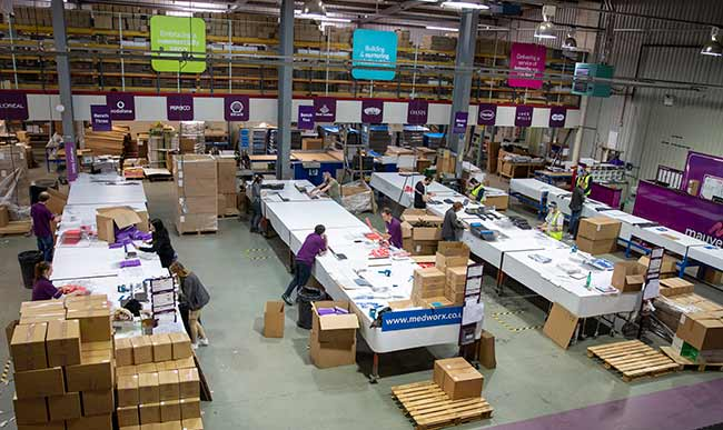 Busy Mauveworx warehouse where the Medworx face shields are manufactured.