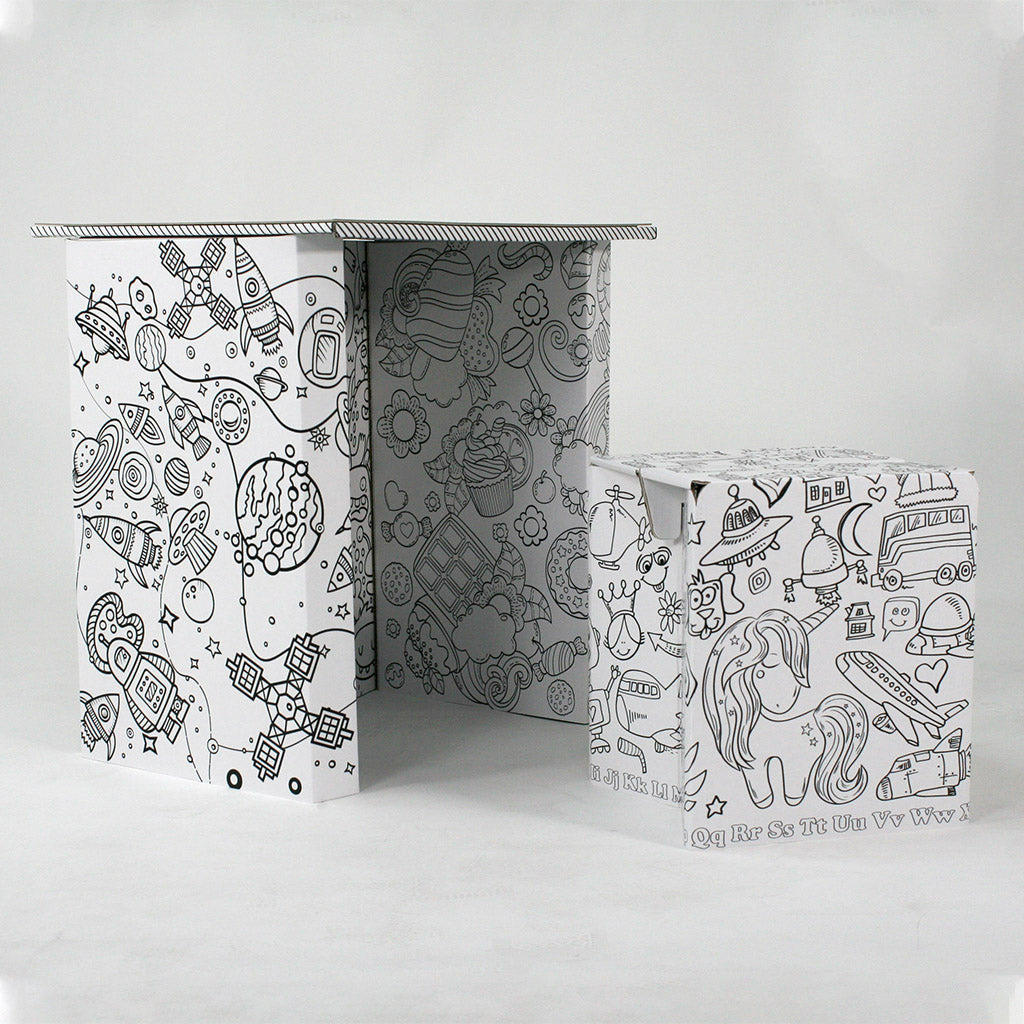 The Pack a Desk Junior with stool. This cardboard desk is covered in blank artwork ready to be coloured in.