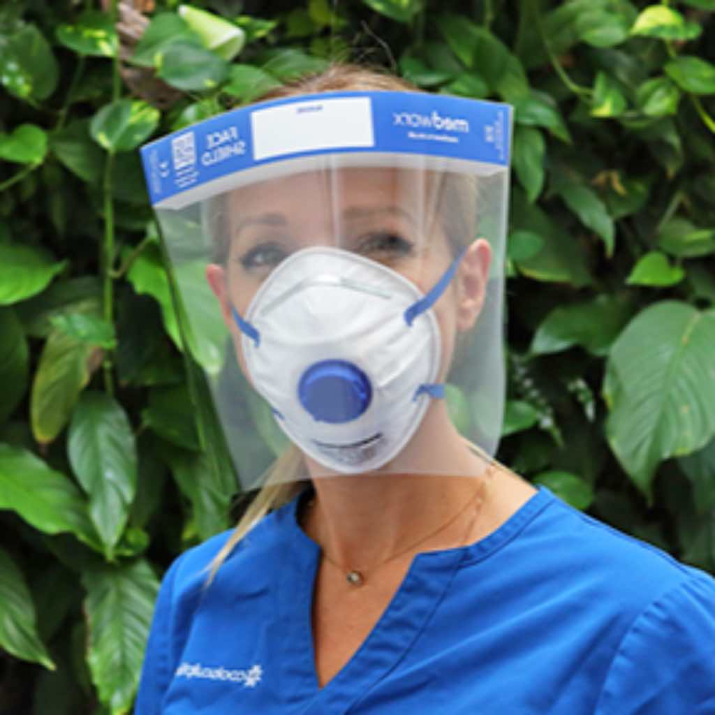 Care worker using Medworx face shield with face mask