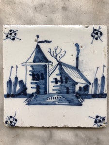 18th century Delft tile with landscape