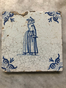17th century delft tile handpainted with woman