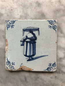 17th century Delft handpainted dutch tile with woman