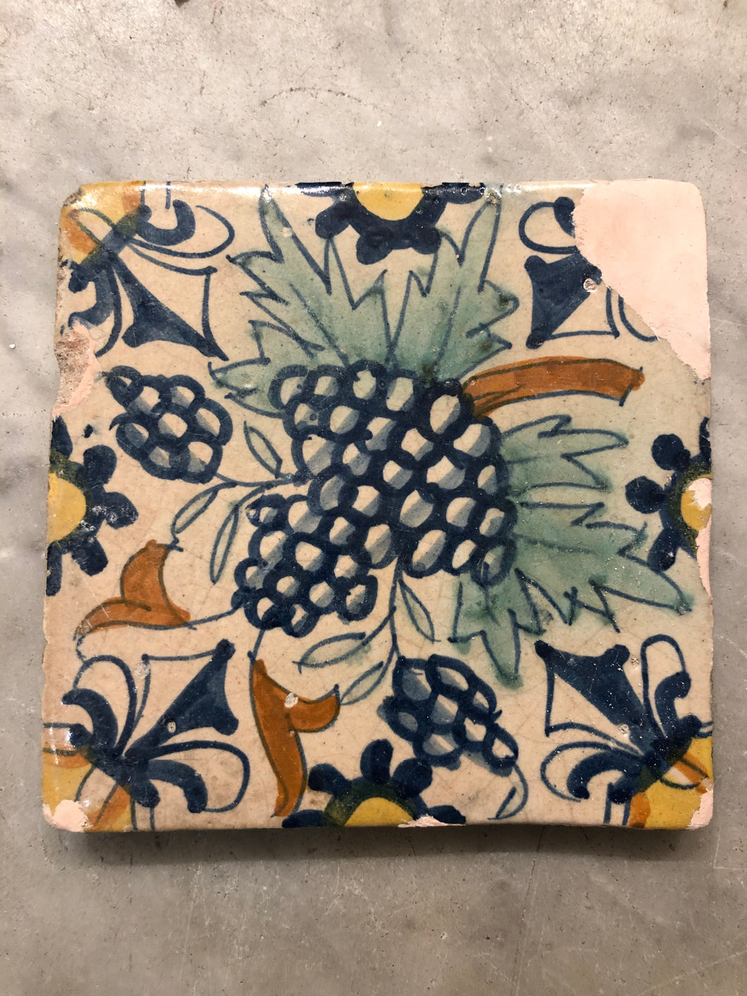 Early delft tile with grapes handpainted