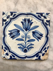 17 th century delft tile with flower/ tulips
